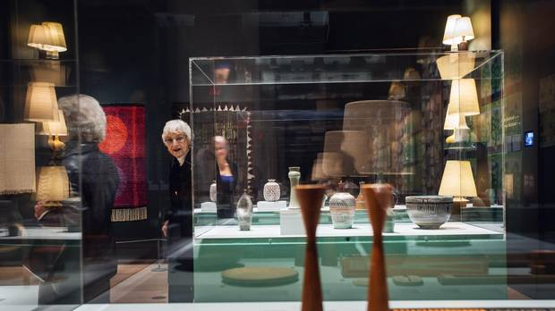 Women admire Canadian studio pottery at the True Nordic exhibition at the Gardiner Museum