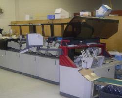 machine that folds and stuffs envelopes