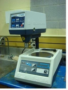 A Ecomet 3 variable speed grinder-polisher