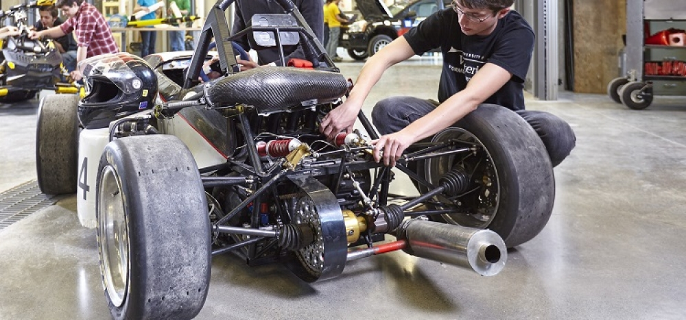 student teams working on their cars