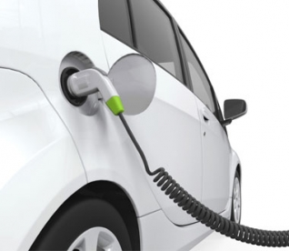 An EV car plugged into an outlet.