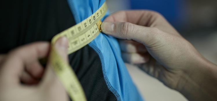 Measurement of client's waist circumference.