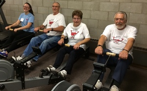 Hardy Heart members on rowing machines.