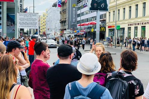 group of students at checkpoint charlie in Berlin