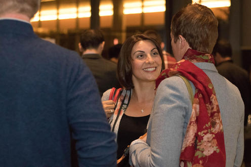 Attendees enjoying a chat after the event