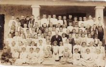 Photo from about 1930 with teacher and about 70 students in Romania.
