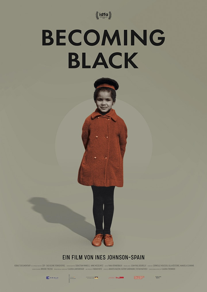 Movie poster: Black girl wearing rust-coloured pea coat and matching shoes.