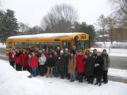 Group of people in front of a school bus