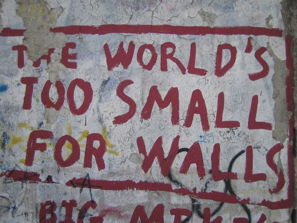 "Graffiti on Berlin Wall: ""The world's too small for walls"""
