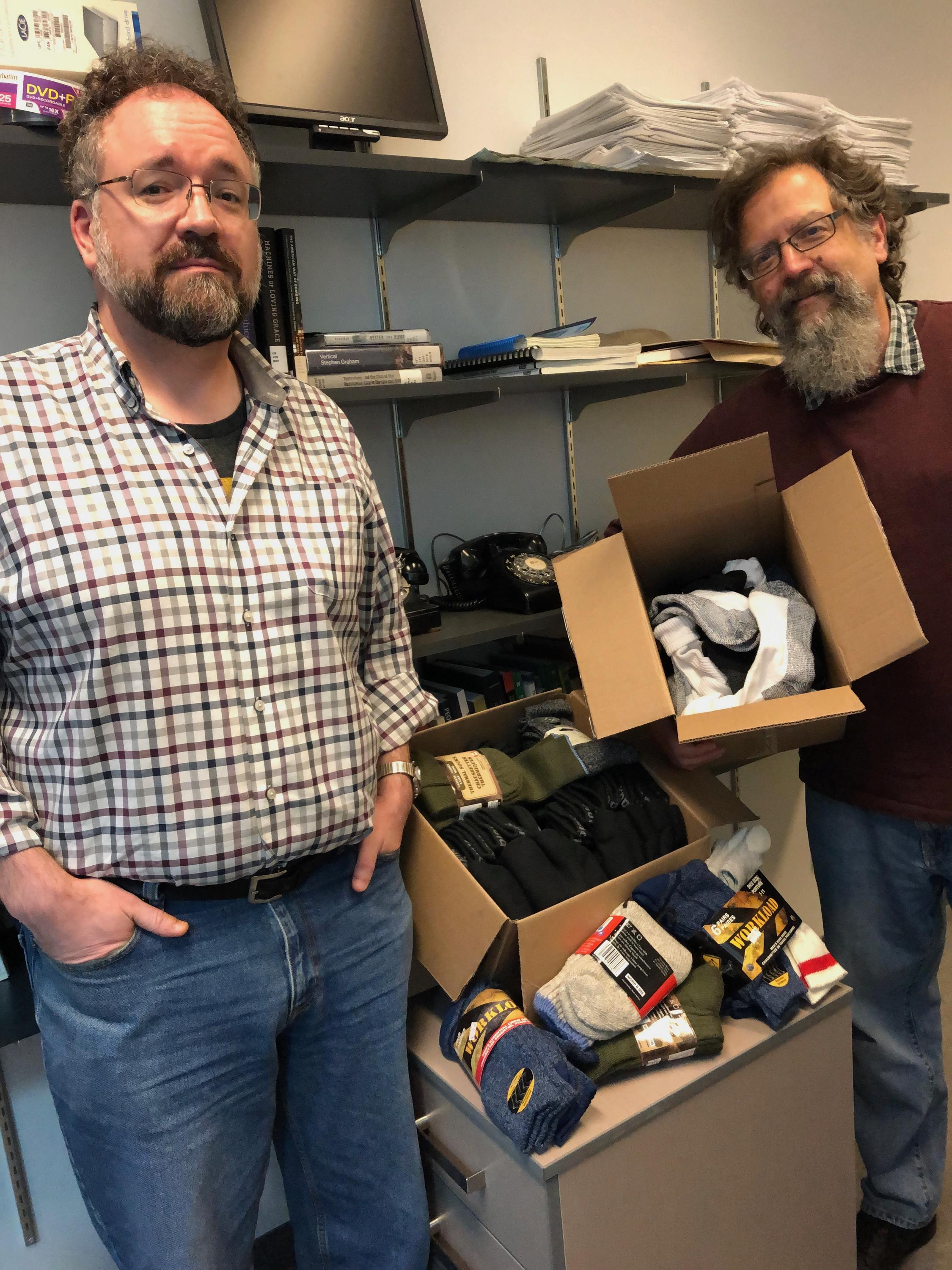 Scott Campbell and Cameron Shelley with their sock collection