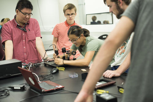 A group of students working in an engineering lab
