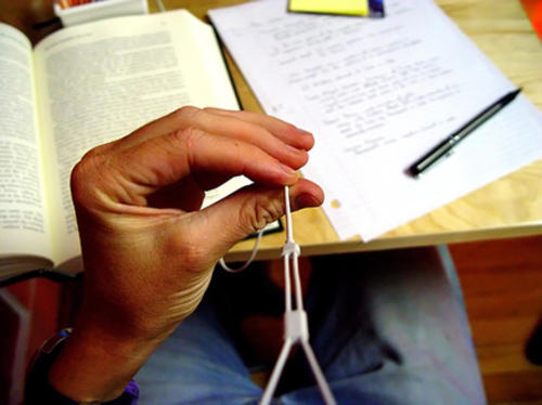 Student playing with headphone cord while studying