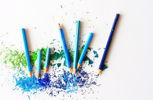 blue pencil crayons and shavings