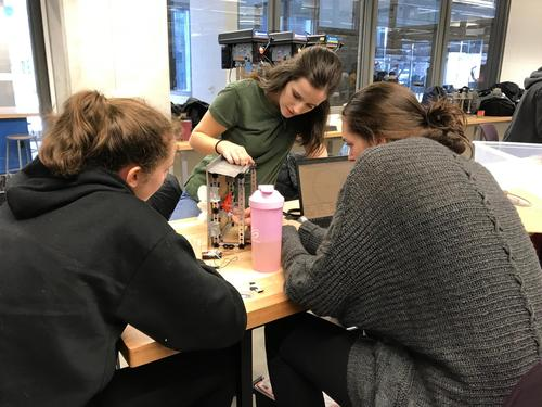 group of students engaged in engineering project