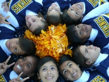 A cheerleading squad lying in a circle