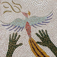 Tile mosaic of hands reaching after a dove