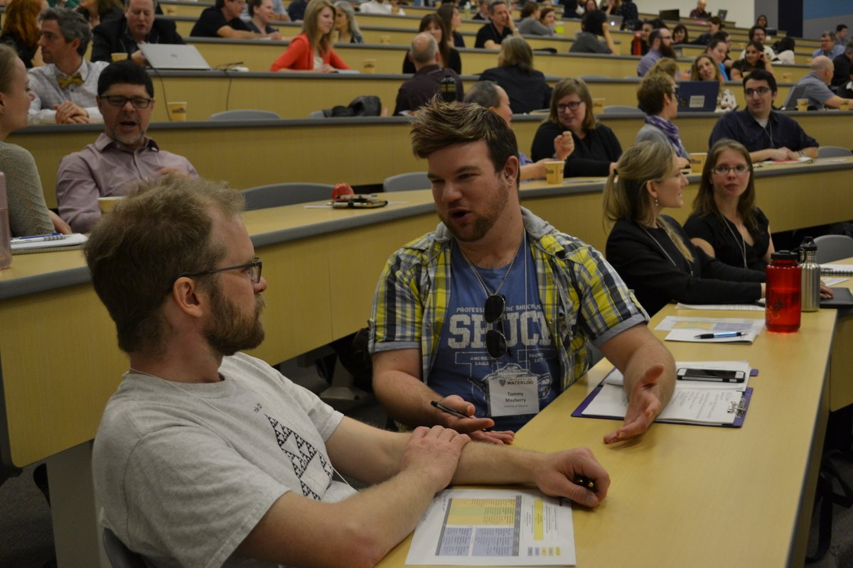 Two participants in discussion at keynote talk for the Cultivating Curiosity in Teaching and Learning conference