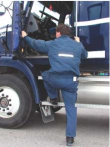 Truck driver entering a truck