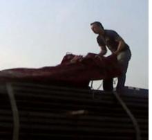 Man tarping a flatbed trailer
