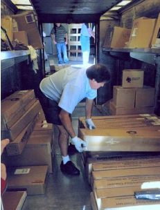 Courier driver handling packages in a courier truck