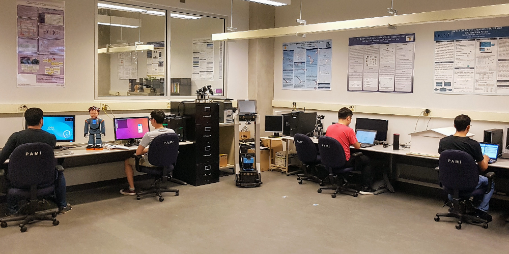 Students working on computers in the lab.