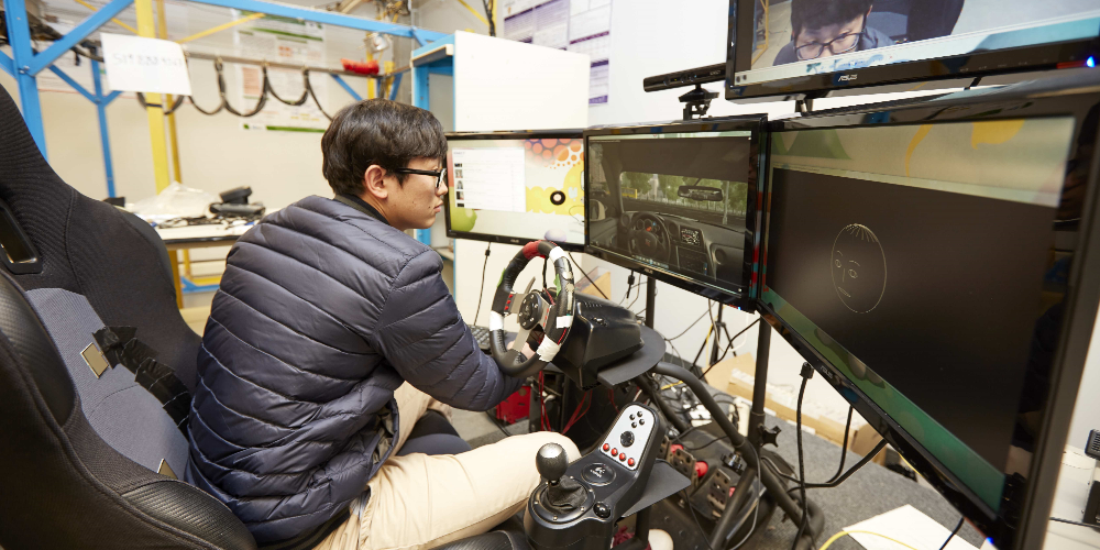 Student using driving simulator.
