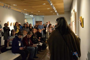 Artist Catherine Dallaire speaks about her pieces at the Gallery Exhibit Launch