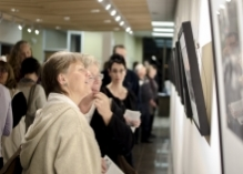 women admiring a photo in the Grebel Gallery