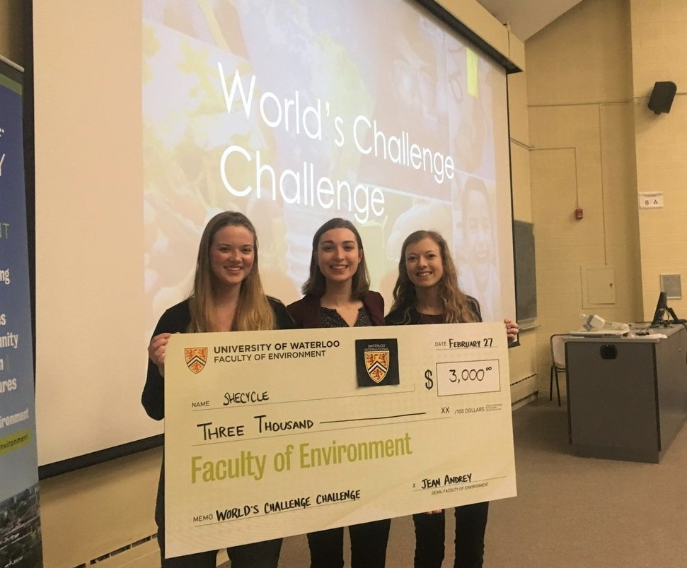 Abby Loewen, Anna Kuepfer and Leah Wouda hold prize of $3000 dollar cheque
