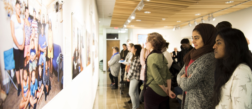 people viewing photo exhibit.