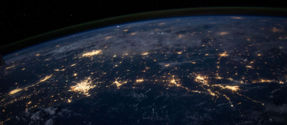 dark side of the globe with lights visible from space
