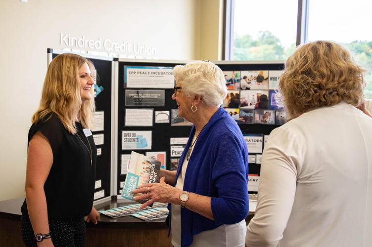 Incubator fellow chatting with guests