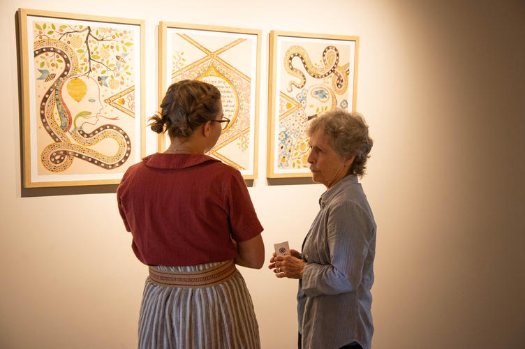 Artist Meg Harder chats with guest about her artwork