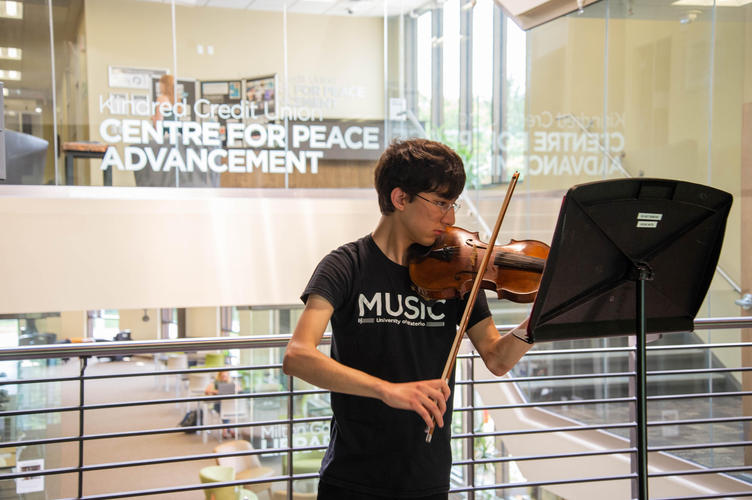 Violinist plays at Centre for Peace Advancement