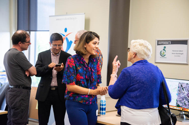 Incubator participants chatting with guests