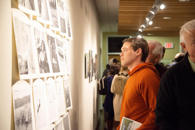 Guests view documentary photographs