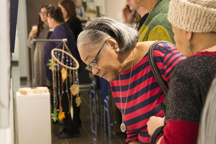 a guest looking at an exhibit