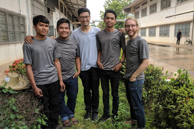 Demine Robotics team in Cambodia standing next to one another
