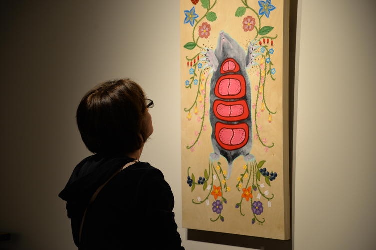 "Guest admiring the piece ""Mole is Honoured"""