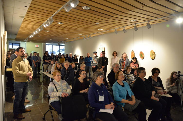 Guests listeneing attentively as Catherine Dallaire speaks about the exhibit