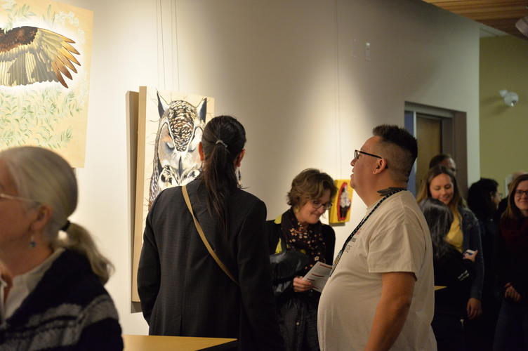 "Guests admiring the piece ""Deer Mouse is Honoured"""