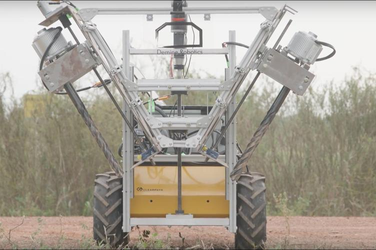 Demine's v3 excavator in a field