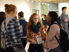 Students chat at Gallery opening
