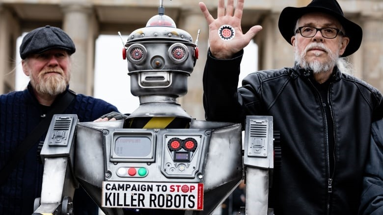 Men pose with robot for Campaign to Stop Killer Robots