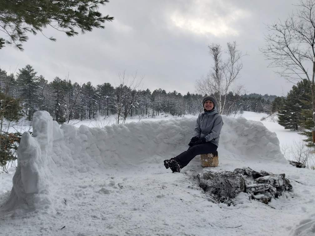 Emily Charron shows off a snow fort that makes her proud