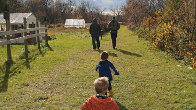 Family walking at Growing Hope Farm