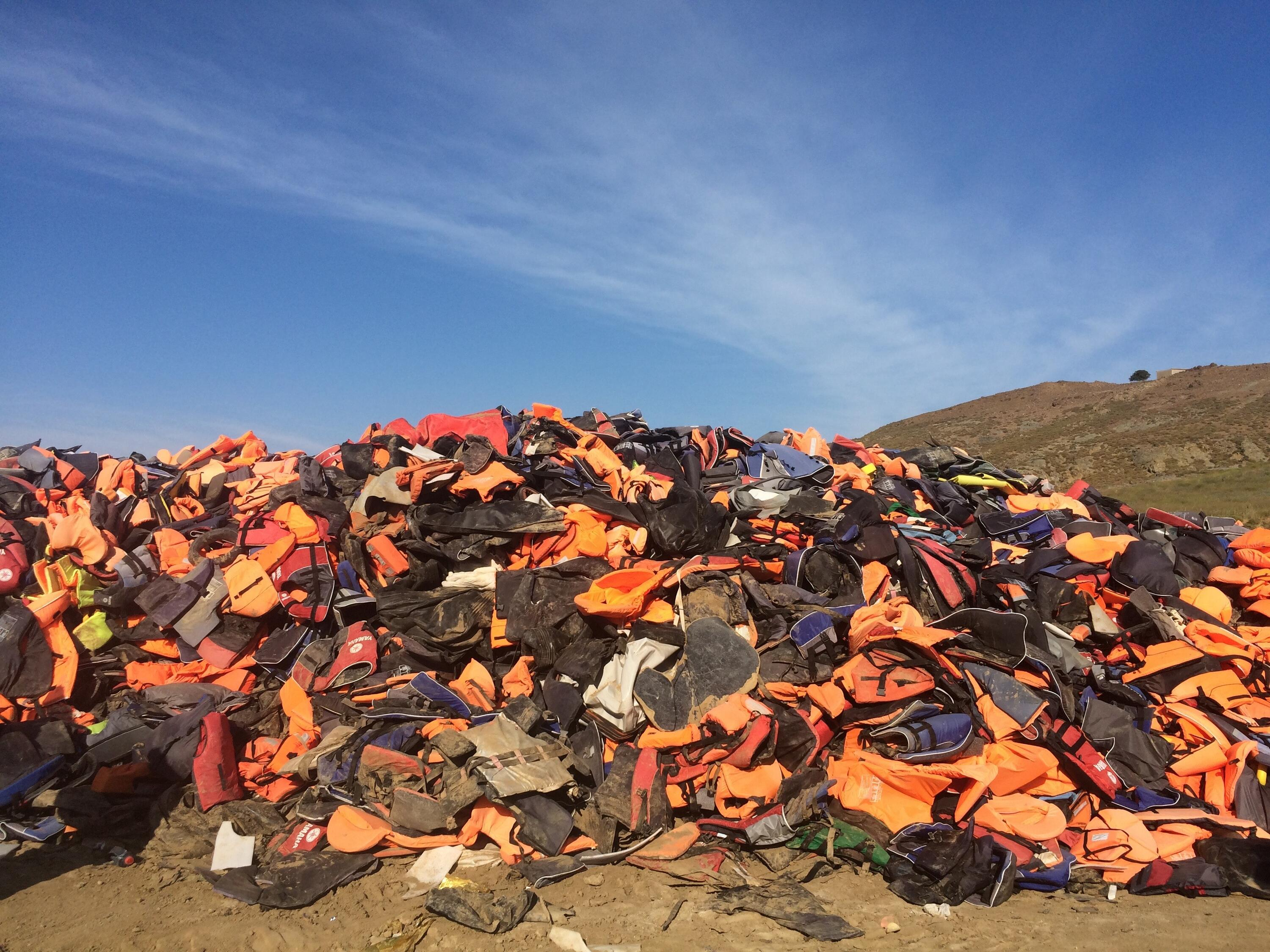 Life Jacket Graveyard on the island of Lesvos, piled with thousands of orange lifejackets
