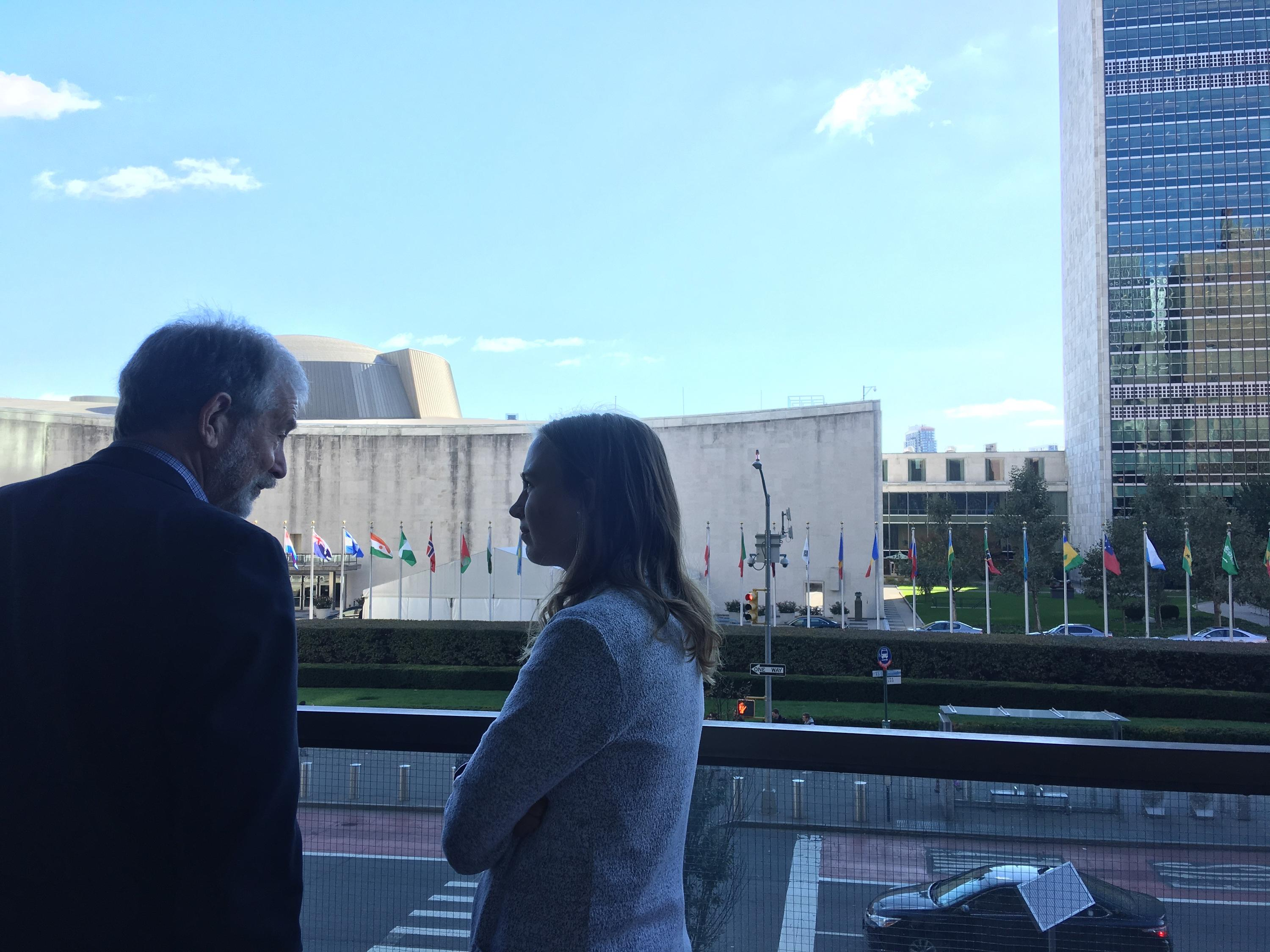 Student talking to Doug Hostetter, Director of MCC's UN office
