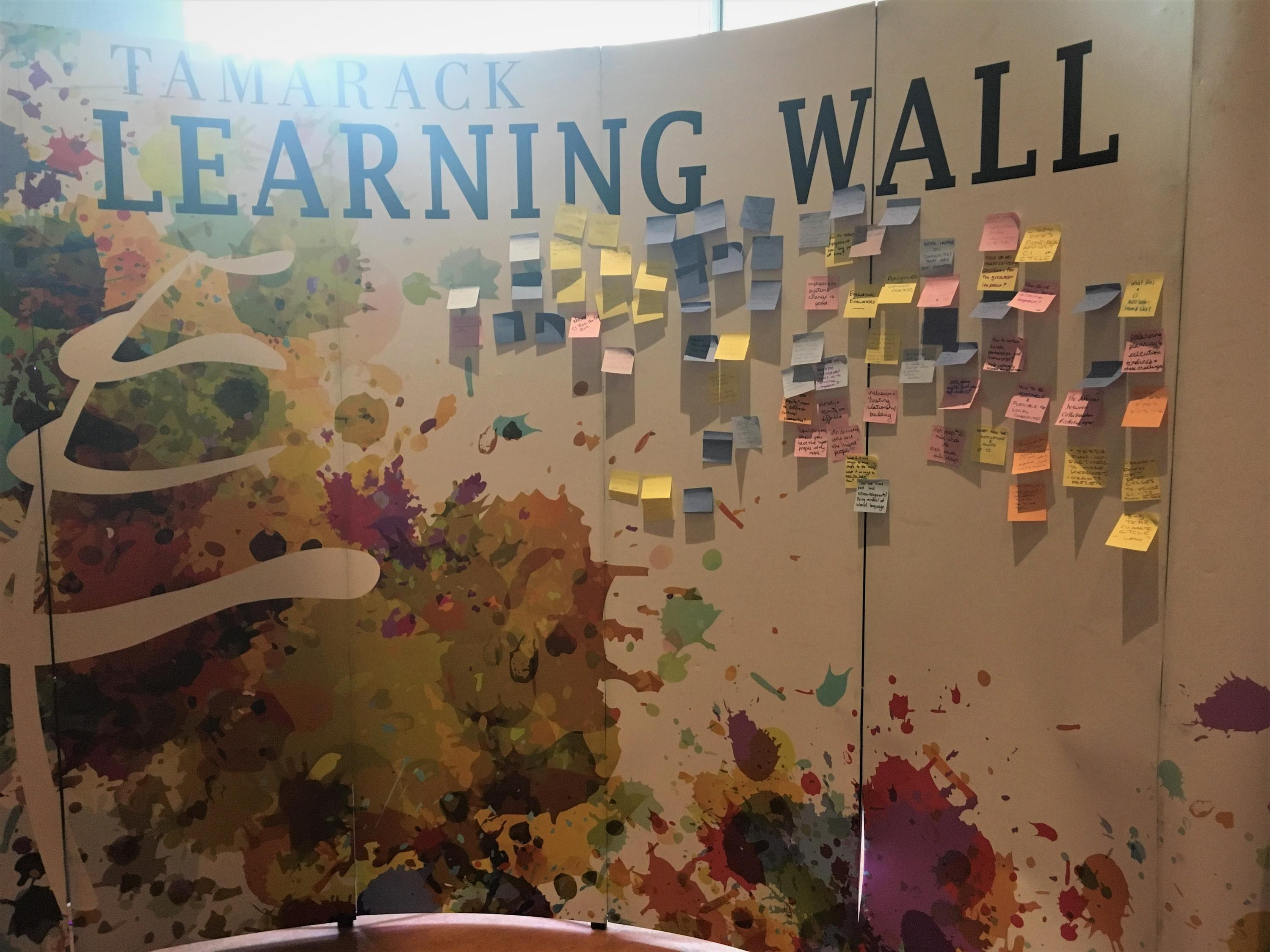 The Learning Wall - attendees placed sticky notes with what they learned from the workshop on a wall together