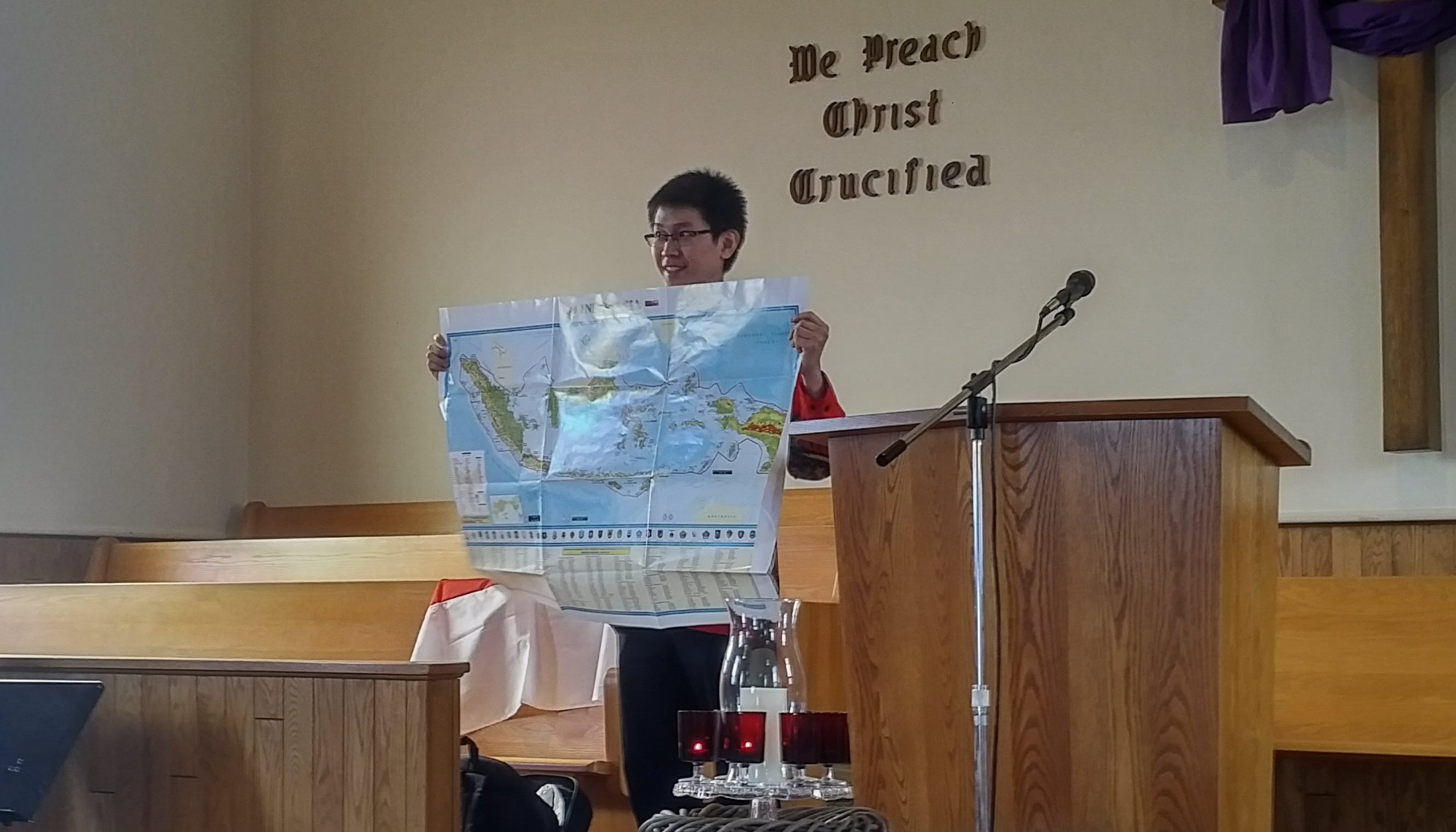Current CPA IVEP participant Lorenzo Fellycyano presenting in front of a Mennonite Congregation